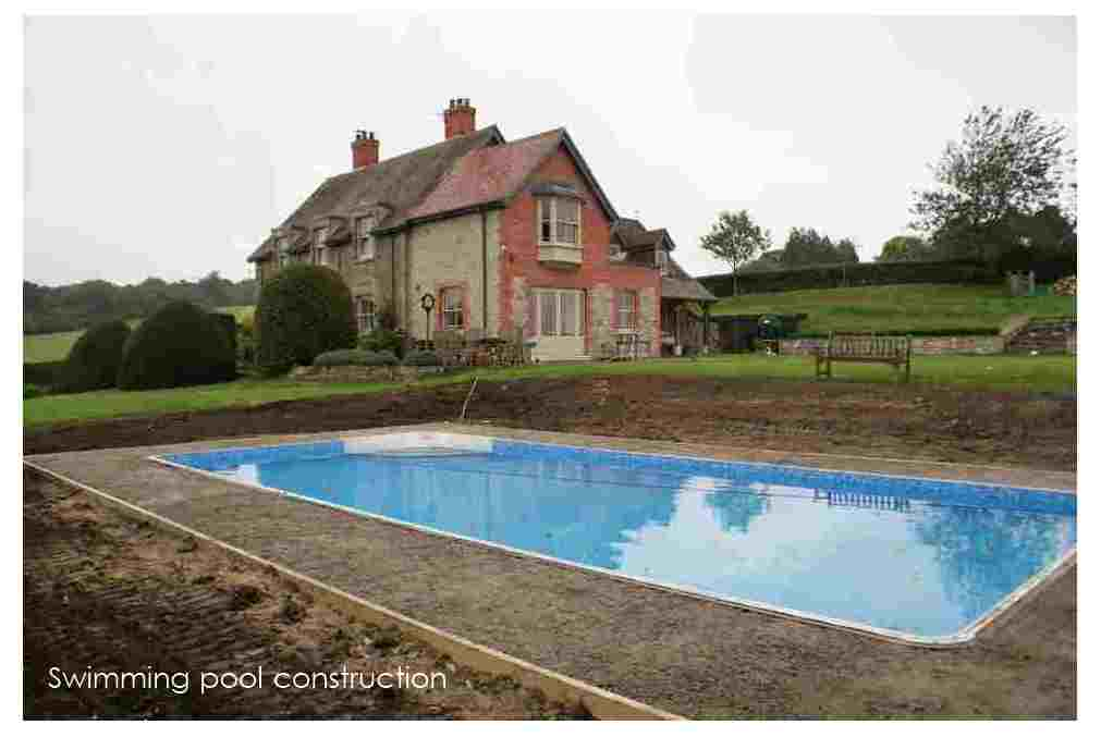 Swimming pool large country garden design Shaftesbury Wiltshire